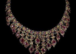 Natural Top Red Ruby & Fancy Sapphire 728 Cts Necklace on icollector.com auction site. How much should I bid?