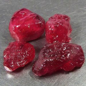 Lead glass-filled, uncut rubies
