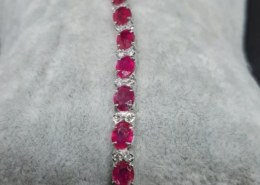 18 K Gold bracelet with Rubies on Catawiki auction. Are these natural or composite rubies?